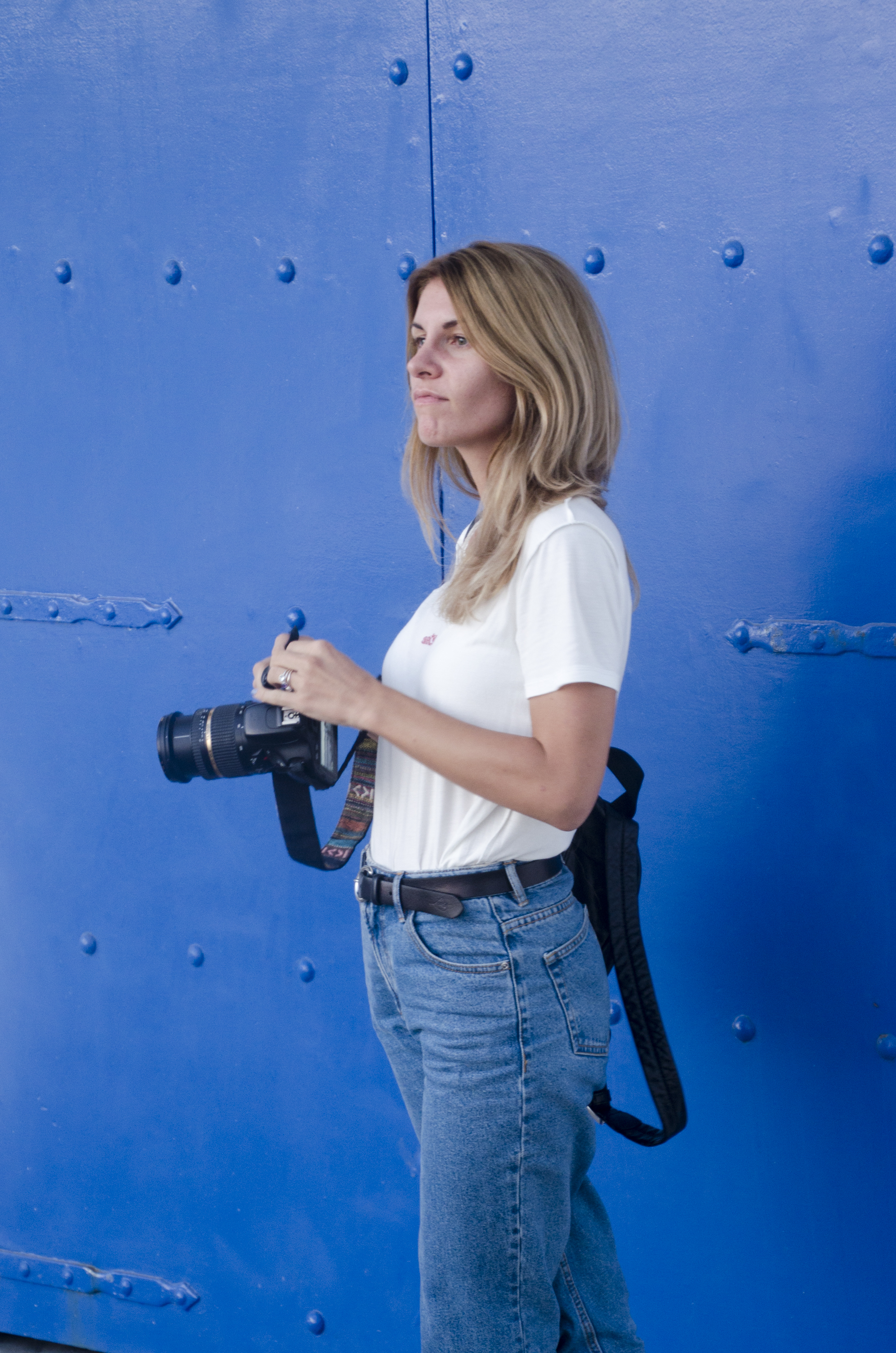 girl photographer on blue background